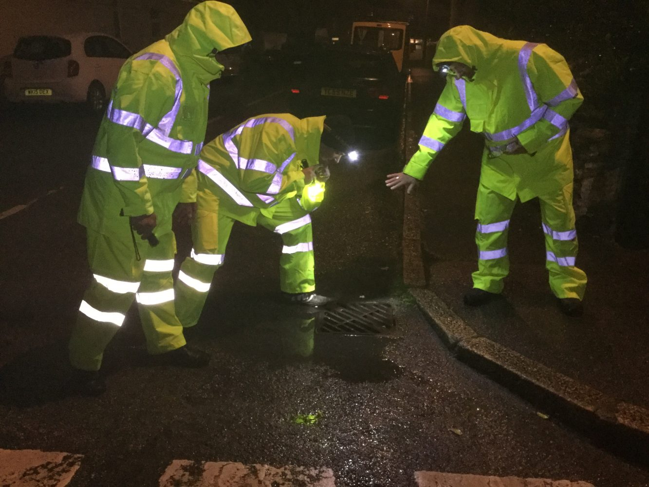 Portreath Flood Group volunteers check drain levels during the test exercise in December 2017