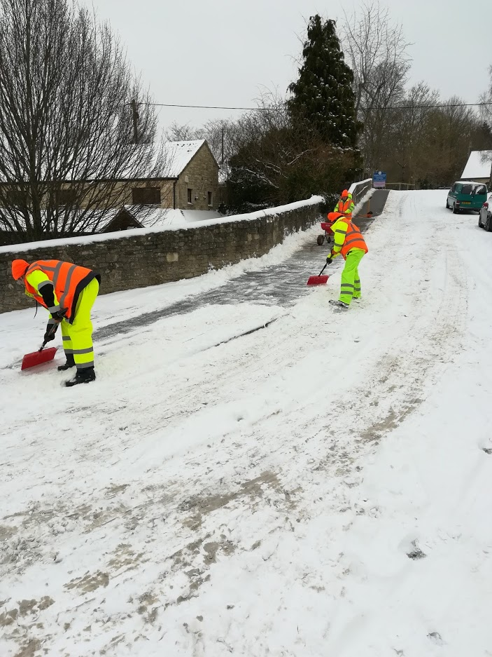 Snow wardens clearing the road