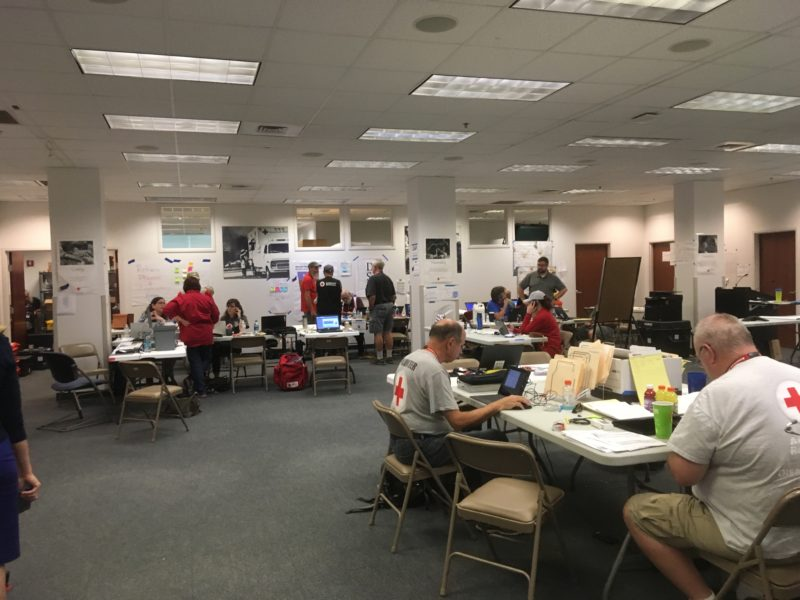 Red Cross volunteers sat working in the Red Cross Operation Centre in Atlanta, Georgia in the United States.